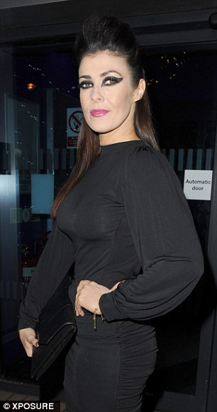 Seeing double?Kym, who is dating personal trainer Matt Baker, appeared to take inspiration from The Addams Family matriarch Morticia in her sweeping black gown