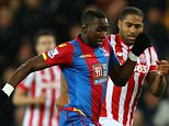 STOKE ON TRENT, ENGLAND - DECEMBER 19: Yannick Bolasie of Crystal Palace and Glen Johnson of Stoke City compete for the ball during the Barclays Premier League match between Stoke City and Crystal Palace at the Britannia Stadium on December 19, 2015 in Stoke on Trent, England.  (Photo by Richard Heathcote/Getty Images)