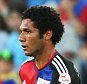 BASEL, SWITZERLAND - AUGUST 05: Mohamed Elneny of FC Basel runs with the ball during the UEFA Champions League third qualifying round 2nd leg match between FC Basel 1893 and KKS Lech Poznan at St. Jakob-Park on August 5, 2015 in Basel, Switzerland. (Photo by Philipp Schmidli/Getty Images)