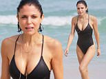 EXCLUSIVE: Real Housewives of NYC star Bethenny Frankel in a black one piece swimsuit at the beach in Miami Beach, FL. Bethenny is spending her holidays alone, without her daughter. She relaxed by taking a swim in the ocean.\n\nPictured: Bethenny Frankel\nRef: SPL1200449  251215   EXCLUSIVE\nPicture by: Pichichi / Splash News\n\nSplash News and Pictures\nLos Angeles: 310-821-2666\nNew York: 212-619-2666\nLondon: 870-934-2666\nphotodesk@splashnews.com\n