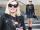 UK CLIENTS MUST CREDIT: AKM-GSI ONLY\nEXCLUSIVE: **SHOT ON 12/24/15** Beverly Hills, CA - Young Hollywood star Emma Roberts stops by Olive & June Nail Spa looking cute as usual, wearing a black leather jacket over a black graphic tee, a denim skirt showing her legs and stylish purple suede booties.\n\nPictured: Emma Roberts\nRef: SPL1200842  251215   EXCLUSIVE\nPicture by: AKM-GSI / Splash News\n\n