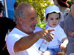 EXCLUSIVE: Sir Philip Green pictured with Baby Eric on sandy lane beach in Barbados  Pictured: Sir Philip Green Ref: SPL1200681  261215   EXCLUSIVE Picture by: 246paps/Splash News  Splash News and Pictures Los Angeles: 310-821-2666 New York: 212-619-2666 London: 870-934-2666 photodesk@splashnews.com