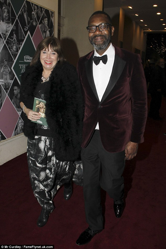 Loved up: Lenny Henry stayed close to Lisa Makin as they enjoyed something of a date night