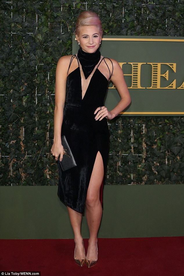 That's a LOTT of flesh to be showing off! Pop star Pixie was typically on display in her LBD