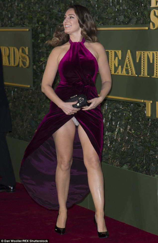 Whoops! Kelly fell foul of the windy evening as she made her grand entrance at the star-studded bash
