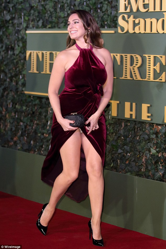 Lacking subtelty: The 35 year-old - who hails from Rochester - put on a leggy display in the dress, which featured halter-beck detail and a crotch-high slit