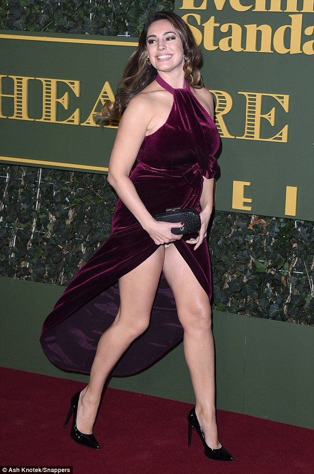 Putting on a good show: Model Kelly Brook commanded attention when she attended the Evening Standard Theatre Awards on Sunday - and flashed her knickers