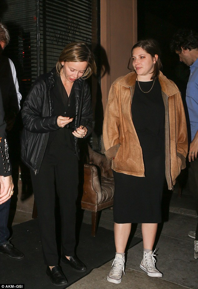 Cool and casual: Georgia donned a black dress, worn white Converse sneakers, and a leather jacket