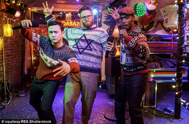 Popular: Seth Rogern's holiday-themed comedy The Night Before opened in fourth place with a first weekend gross of $10 million. Rogen is pictured center with co-stars Joseph Gordon-Levitt and Anthony Mackie