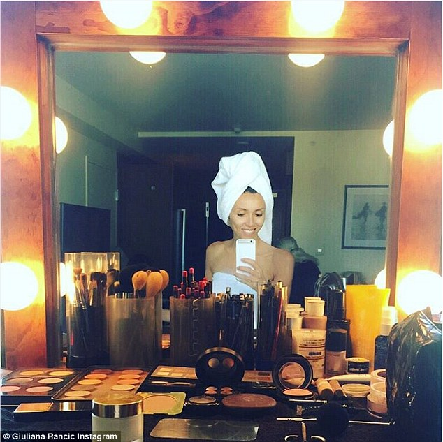 The beginning:Stars were seen getting ready for the American Music Awards on Sunday. E! star Giuliana Rancic posed makeup-free while wearing nothing but a white towel as she sat in her makeup room