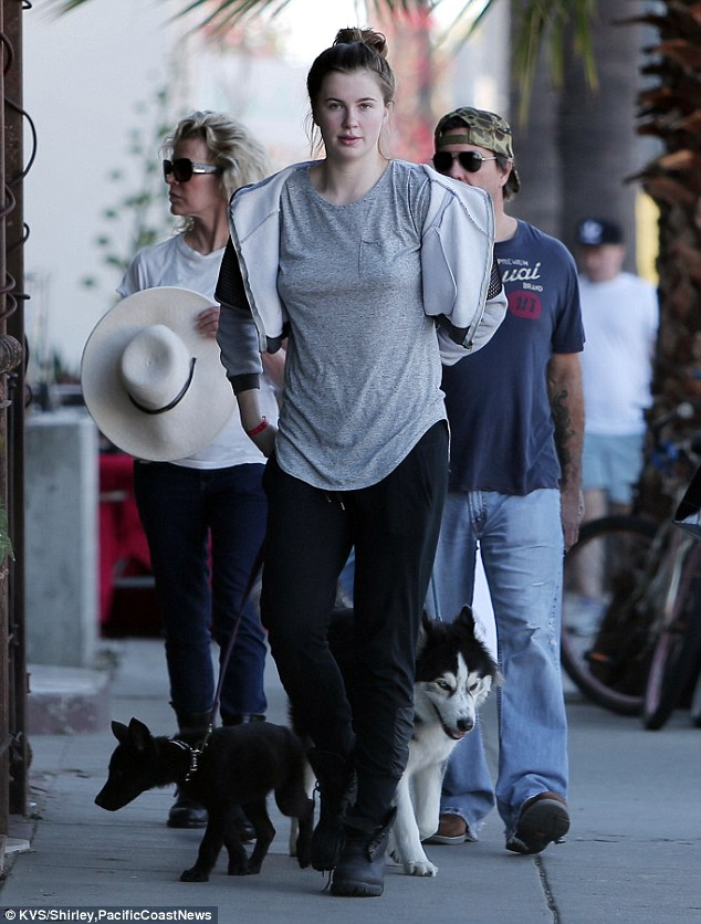 Family outing: She later met up with her mother Kim to walk their dogs, as she could be seen holding onto the leash for her Siberian Husky Koda