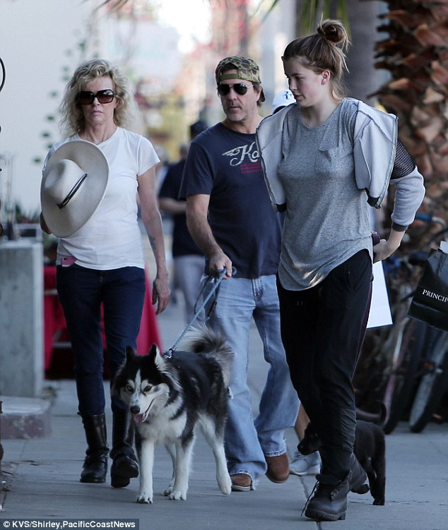 Mother-daughter bonding: Ireland Baldwin and mom Kim Basinger - as well as her beau Mitch Stone - stepped out in Los Angeles together on Saturday to walk their dogs