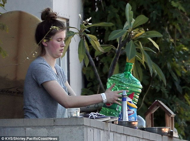Neat: The daughter of Kim Basinger and Alec Baldwin could be seen organizing her things as she straightened up her balcony