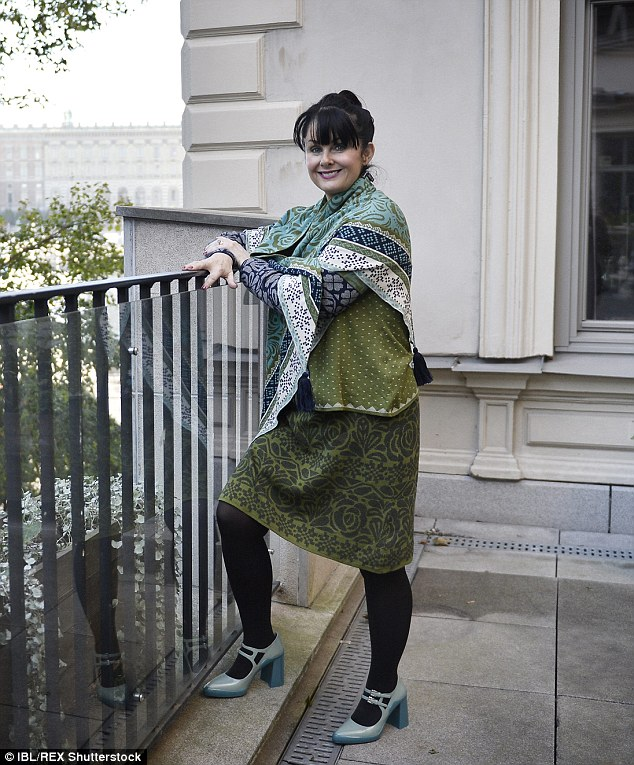 Marian Keyes shows off her new figure and in October. The novelist has described the experience of shedding weight and tackling her urge to comfort eat in a powerful new article