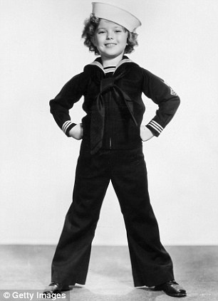 Studio portrait Shirley Temple in 1935 wearing a sailor's uniform and cap