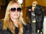 26.DEC.2015 - LOS ANGELES - USA\n*AVAILABLE FOR UK SALE ONLY*\n** EXCLUSIVE ALL ROUND PICTURES **\nGerman model Heidi Klum checks in at Los Angeles international airport for a flight overseas to see rumored love cheat Vito Schnabel. Rumors are rife that her boyfriend Vito is having a affair with Hollywood actress Dakota Johnson as they were pictured sitting affectionately close in a bar in New York. Heidi spent Christmas with her kids in Los Angeles and before leaving the kids with her ex husband Seal.\nBYLINE MUST READ : XPOSUREPHOTOS.COM\n***UK CLIENTS - PICTURES CONTAINING CHILDREN PLEASE PIXELATE FACE PRIOR TO PUBLICATION ***\n*UK CLIENTS MUST CALL PRIOR TO TV OR ONLINE USAGE PLEASE TELEPHONE 0208 344 2007*