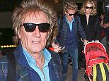 Los Angeles, CA - Singer Rod Stewart and wife Penny Lancaster arrive at LAX after spending the holidays in London.  Rod signed autographs for fans on his way out looking dapper as usual in a plaid blazer and suede oxford shoes. AKM-GSI        December 27, 2015 To License These Photos, Please Contact : Steve Ginsburg (310) 505-8447 (323) 423-9397 steve@akmgsi.com sales@akmgsi.com or Maria Buda (917) 242-1505 mbuda@akmgsi.com ginsburgspalyinc@gmail.com