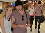 EXCLUSIVE\n December 28 2015\n Ashton Irwin and his model girlfriend spotted leaving Sydney Australia with members Calum Hood, Michael Clifford and Luke Hemmings bound for BALI after jetting into Sydney to spend Christmas with their families.\n