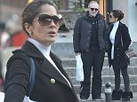 EXCLUSIVE TO INF. December 27, 2015: Salma Hayek and Francois-Henri Pinault seen on holiday in Gstaad, Switzerland. The couple were waiting for a taxi to their hotel. Mandatory Credit: INFphoto.com Ref Code: inffr-01/203642