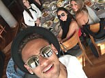 Neymar posted this Instagram photo (left) on Sunday afternoon as he dined with friends