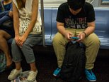 NEW YORK, NY - SEPTEMBER 4: A young man plays a video game September 4, 2014 while riding the subway in the Manhattan borough of New York. (Photo by Robert Nickelsberg/Getty Images)