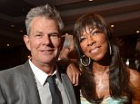 CENTURY CITY, CA - MAY 02:  Musican David Foster (L) and singer Natalie Cole attend the 21st annual Race to Erase MS at the Hyatt Regency Century Plaza on May 2, 2014 in Century City, California.  (Photo by Jason Kempin/Getty Images for Race to Erase MS)