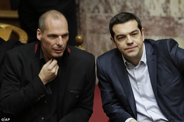 The attack on Finance Minister Yanis Varoufakis, pictured with Greece's Prime Minister Alexis Tsipras, came the day before a meeting between the government and its eurozone creditors to unlock vital bailout funds
