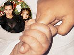 close up shot of North holding hands with her little brother Saint.\nMust link to Link: https://www.kimkardashianwest.com/behind-the-scenes/546-saint-north-west-bffs/