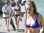 3 Jan 2016  - BARBADOS  - BARBADOS *** EXCLUSIVE PICTURES - MUST CALL FOR PRICING - STRICTLY NO WEB USAGE - FOR UK NEWSPAPERS ONLY *** BRITISH CARA DELEVINGNE WITH GIRLFRIEND ST. VINCENT ALONG WITH SUKI WATERHOUSE AND HER FAMILY GO SURFING IN THE SOUTH OF BARBADOS. CARA AND SUKI SHOWED OFF THEIR SKILLS AS THEY RODE THE WAVES! CARA'S GIRLFRIEND WAS ALSO SURFING BUT WASNT SO KEEN TO CARRY ON AFTER FALLING HEAD FIRST INTO THE WATER! CARA AND HER GIRLFRIEND LOOKED TO BE VERY MUCH IN LOVE AS CARA TAUGHT HER THE ROPES!  BYLINE MUST READ : XPOSUREPHOTOS.COM ***UK CLIENTS - PICTURES CONTAINING CHILDREN PLEASE PIXELATE FACE PRIOR TO PUBLICATION *** **UK CLIENTS MUST CALL PRIOR TO TV OR ONLINE USAGE PLEASE TELEPHONE  442083442007