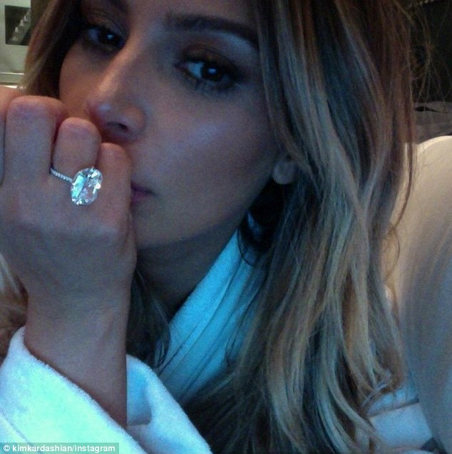 Checkout my bling: Kim Kardashian posted this throwback selfie with her diamond from Kanye West to promote her new book Selfish, which comes out May 5