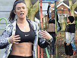 PICTURE BYLINE --- optimusimages.co.uk\nPICTURES SHOW --- Coronation Street star Kym Marsh seen keeping up her fitness regime today during a workout at a local park in Manchester. Kym could be seen doing chin ups and pushups improvising with some of the apparatus available. Kym's PT and new man Matt Baker was on hand looking over her technique.\n03/01/15\n**Exclusive pictures please agree a fee before any use** \n***Notice, no web or TV usage without prior agreeing a fee***\nFor more info please Email pictures@optimusimages.co.uk or visit www.optimusimages.co.uk\n