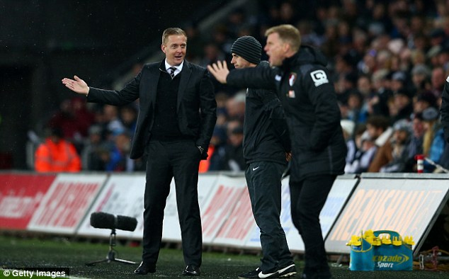 Monk (left) is under pressure as his team sit a lowly 14th in the Premier League table after 13 games