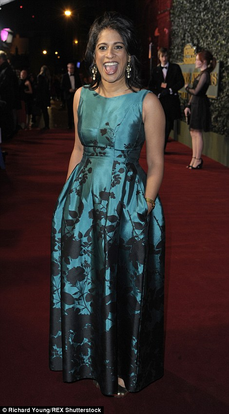Theatre director Indhu Rubasingham laughed on the red carpet in a printed teal and black floor-length gown and kept her hands warm in the in-built pockets