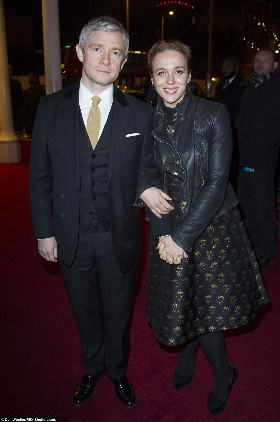 Martin Freeman and wife Amanda Abbington wrapped up against the cold: The Sherlock star looked dapper in a  well-cut three-piece suit, while his actress wife wore two things that were notably absent on anyone else - a pair of tights and a jacket