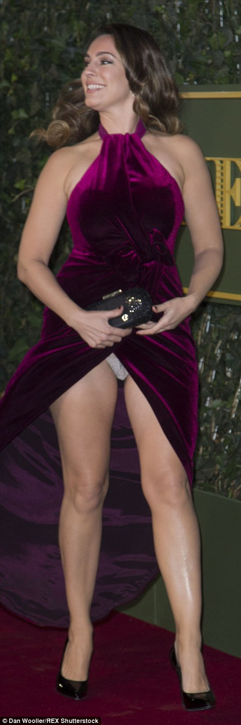 Kelly Brooke was left as red-faced as her frock blew open to expose her white-lace underwear