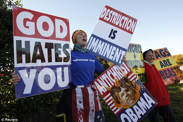 Hate: Members of the Westboro Baptist Church hold anti-gay signs at Arlington National Cemetery in Virginia on Veterans Day, November 11, 2010