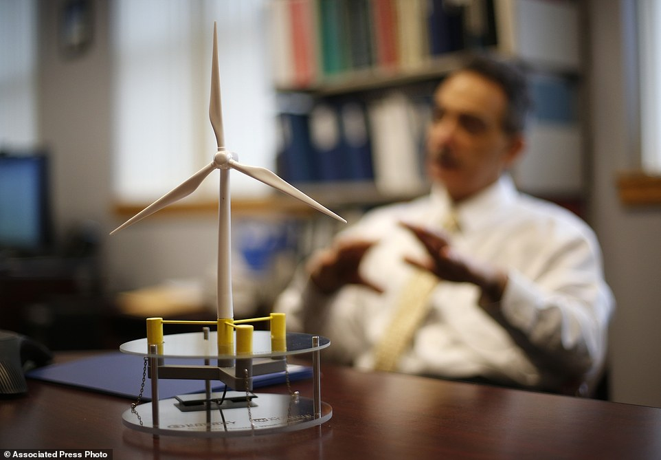 In this Friday, Nov. 20, 2015, photo, a scale model of a wind turbine sits on a table as Habib Dagher, director of the University of Maine¿s Advanced Structures, discusses the university¿s offshore wind project, VolturnUS.