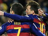Barcelona's Argentinian forward Lionel Messi (R) celebrates with Barcelona's Turkish midfielder Arda Turan (C) and Barcelona's midfielder Andres Iniesta after scoring during the Spanish Copa del Rey (King's Cup) round of 16 first leg football match FC Barcelona vs RCD Espanyol at the Camp Nou stadium in Barcelona on January 6, 2016.   AFP PHOTO/ PAU BARRENAPAU BARRENA/AFP/Getty Images