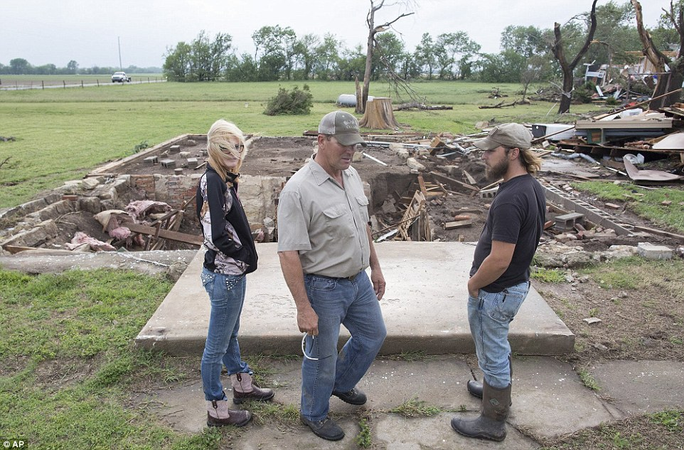 Inspection: Neighbors of Craig Foraker check out his property after a tornado devastated the area near Bentley, Kansas