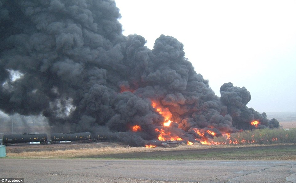 Fire: This is the moment an oil train derailed and caught fire as authorities confirmed that 10 tanker cars are on fire and billowing black smoke