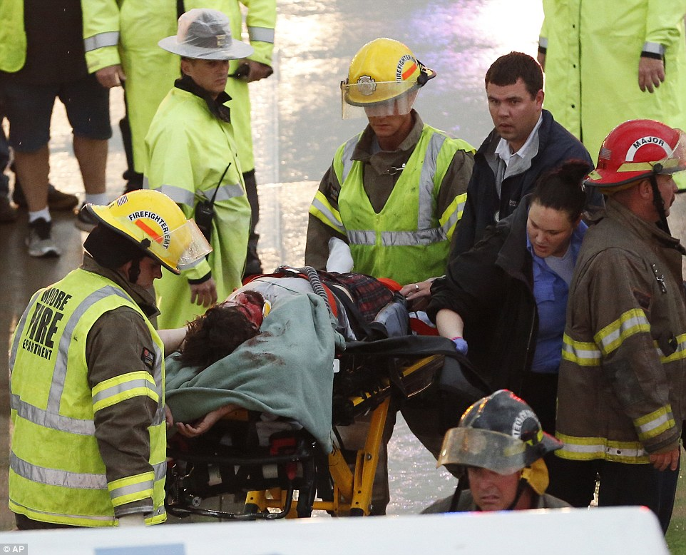 Rescue: First responders take a passenger of a truck involved in an accident on Interstate 35 during severe weather to an ambulance, in Moore