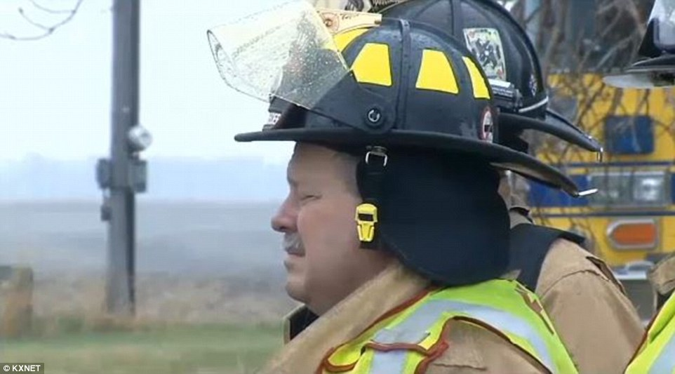 Damage control: Firefighters from four area communities responded to the fire, along with regional hazardous materials teams