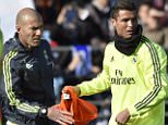 "Real Madrid's Portuguese forward Cristiano Ronaldo (R) gives a bib to Real Madrid's new French coach Zinedine Zidane during his first training session as coach of Real Madrid at the Alfredo di Stefano stadium in Valdebebas, on the outskirts of Madrid, on January 5, 2016. Real Madrid legend Zinedine Zidane promised to put his ""heart and soul"" into managing the Spanish giants after he was sensationally named as coach following Rafael Benitez's unceremonious sacking.   AFP PHOTO/ GERARD JULIENGERARD JULIEN/AFP/Getty Images"