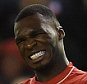 LIVERPOOL, ENGLAND - NOVEMBER 29:  (THE SUN OUT, THE SUN ON SUNDAY OUT) Christian Benteke of Liverpool reacts during the Barclays Premier League match between Liverpool and Swansea City at Anfield on November 29, 2015 in Liverpool, England.  (Photo by John Powell/Liverpool FC via Getty Images)