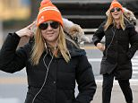 EXCLUSIVE TO INF.\nJanuary 7, 2016: Amy Schumer staying warm in a 'Wear Orange' beanie which calls attention to gun violence and safety, and a black puffer coat listens to music as she is photographed this morning smling and jogging in New York City. Schumer has lots to smile about as she posted photos of her and new boyfriend Chicago furniture designer Ben Hanisch last week.\nMandatory Credit: Elder Ordonez/INFphoto.com Ref: infusny-160