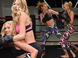 NEW YORK, NY - JANUARY 07:  Victoria's Secret models Martha Hunt (L) and Elsa Hosk box it out wearing Victoria Secret Sport at Aerospace High Performance Center on January 7, 2016 in New York City.  (Photo by Dimitrios Kambouris/Getty Images for Victoria's Secret)