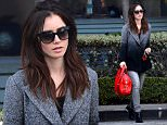 Lily Collins Shops on Robertson With a Red GIVENCHY Bag  Pictured: Lily Collins Ref: SPL1204725  070116   Picture by: All Access Photo  Splash News and Pictures Los Angeles: 310-821-2666 New York: 212-619-2666 London: 870-934-2666 photodesk@splashnews.com