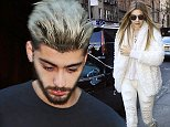 Gigi Hadid looked fashionably striking and displays henna tattoos on hand in all white while out in New York City.  Pictured: Gigi Hadid Ref: SPL1204194  060116   Picture by: Sharpshooter Images / Splash  Splash News and Pictures Los Angeles: 310-821-2666 New York: 212-619-2666 London: 870-934-2666 photodesk@splashnews.com