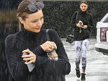 05 Jan 2016- Santa Monica, - USA\n*** STRICTLY AVAILABLE FOR UK AND GERMANY USE ONLY ***\n*** *EXCLUSIVE ALL ROUND PICTURES ***\nMiranda Kerr rushed to her car in the parking garage as the rain began to pour over her. The supermodel did not have an umbrella, which may have been a bad choice, as it progressively rained harder. She even tried texting and drinking her juice while she made her way to the car. She was wearing cat eye sunglasses, a thick black turtle neck, floral printed leggings, and sneaker wedges paired with a black cross body bag. Kerr was sporting a simple beauty look with filled brows, red lip and a low ponytail. Miranda Kerr is a former Victoria's Secret angel, and the ex-wife of Orlando Bloom, the two have a son, Flynn Christopher Bloom, 4, together. \n  \nBYLINE MUST READ : AKM-GSI-XPOSUREPHOTOS.COM\n***UK CLIENTS - PICTURES CONTAINING CHILDREN PLEASE PIXELATE FACE PRIOR TO PUBLICATION ***\n*UK CLIENTS MUST CALL PRIOR TO TV OR ONLINE USAGE PLEASE TELEPHONE 0208 344