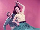 Classic Collection, Page 76, 10399578, 1957, Studio portrait of smiling couple Jiving: woman in full skirt spinning around  (Photo by Popperfoto/Getty Images)